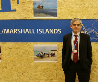 Michael Gerrard, working as a member of the Marshall Islands delegation at COP 21